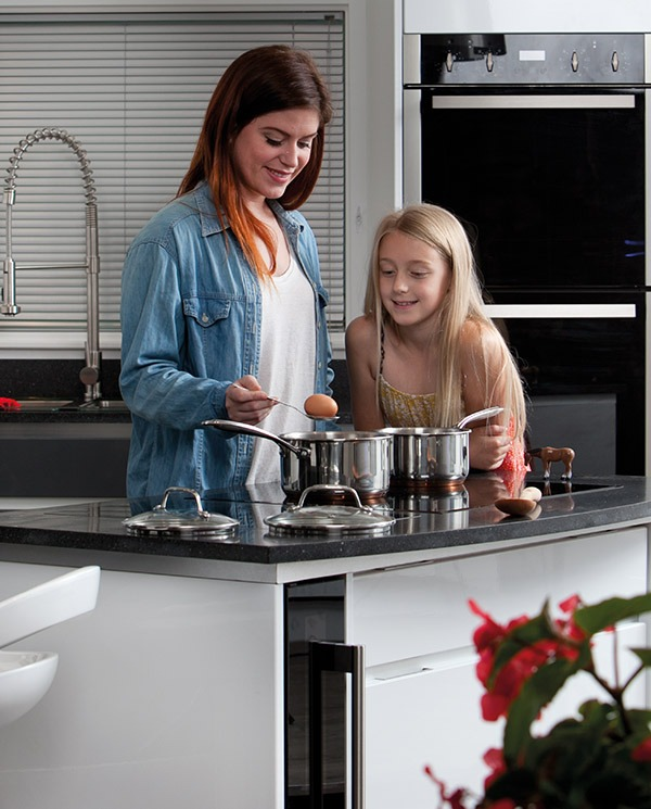 family-cooking-on-electric-hob